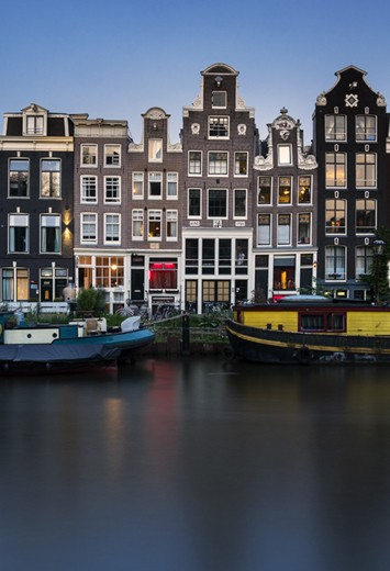 View of a canal with houses in Amsterdam