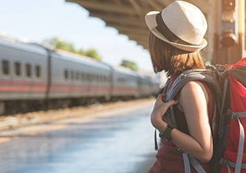 Young woman with backpack at the station