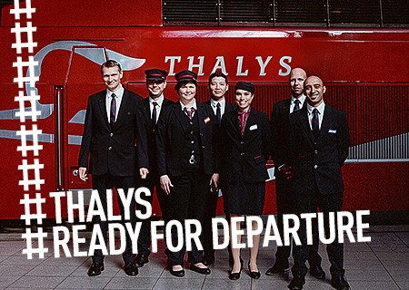 Thalys crew in front of Thalys train